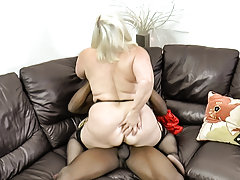 Busty mature lady is having fun with her black friend