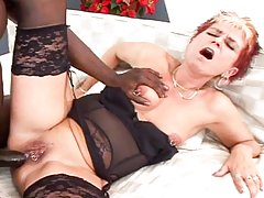 This horny grand mother loves black cocks in her old anus!