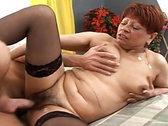 Granny getting fuck and cream pie by that young dude!