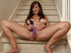 Horny granny masturbating herself alone on the staircase