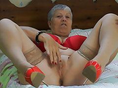 Old granny wearing sexy red underwear and high heels